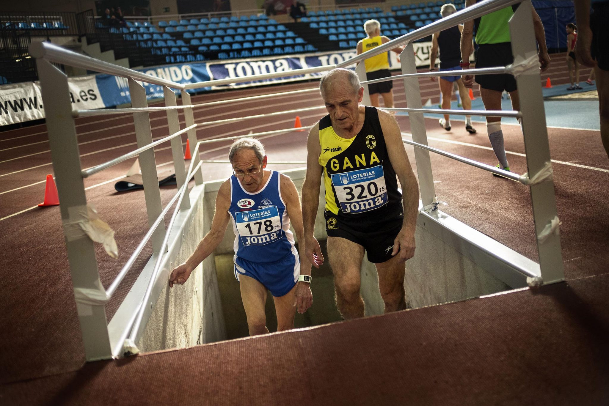 Ángel Cano and another veteran athlete take to the track to compete in the 3000 meters race during the celebration of the Spanish Championships for Veteran Athletics at the Polideportivo de Gallur (Madrid).
